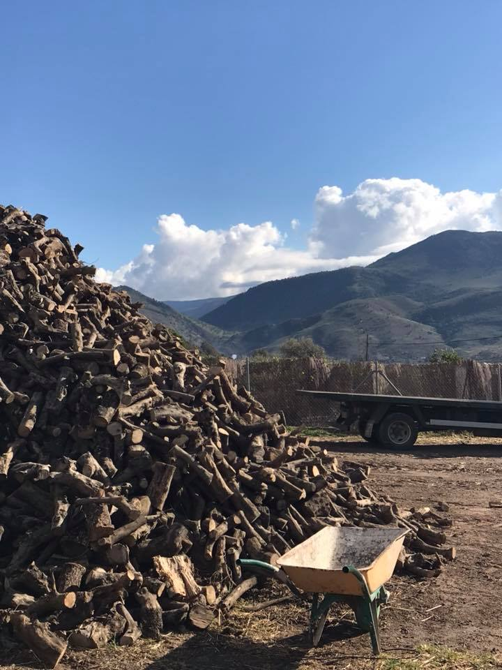 Wood pile with a view onto the Orgiva mountains.